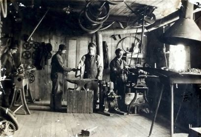 Photographic image of George Foote Foss working at his lathe