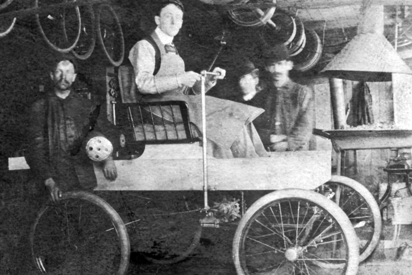 Photographic image of George Foote Foss sitting in the semi-completed Fossmobile