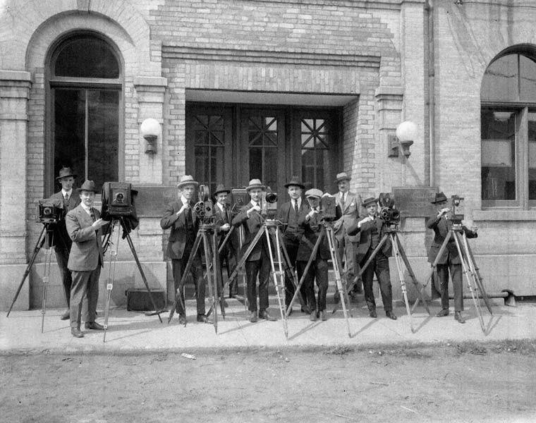 Cameramen outside the Canadian Government Motion Picture Bureau