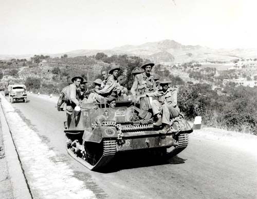 Canadian troops with the Hastings and Prince Edward Regiment in an armoured carrier, advancing north through Italy in July 1943.