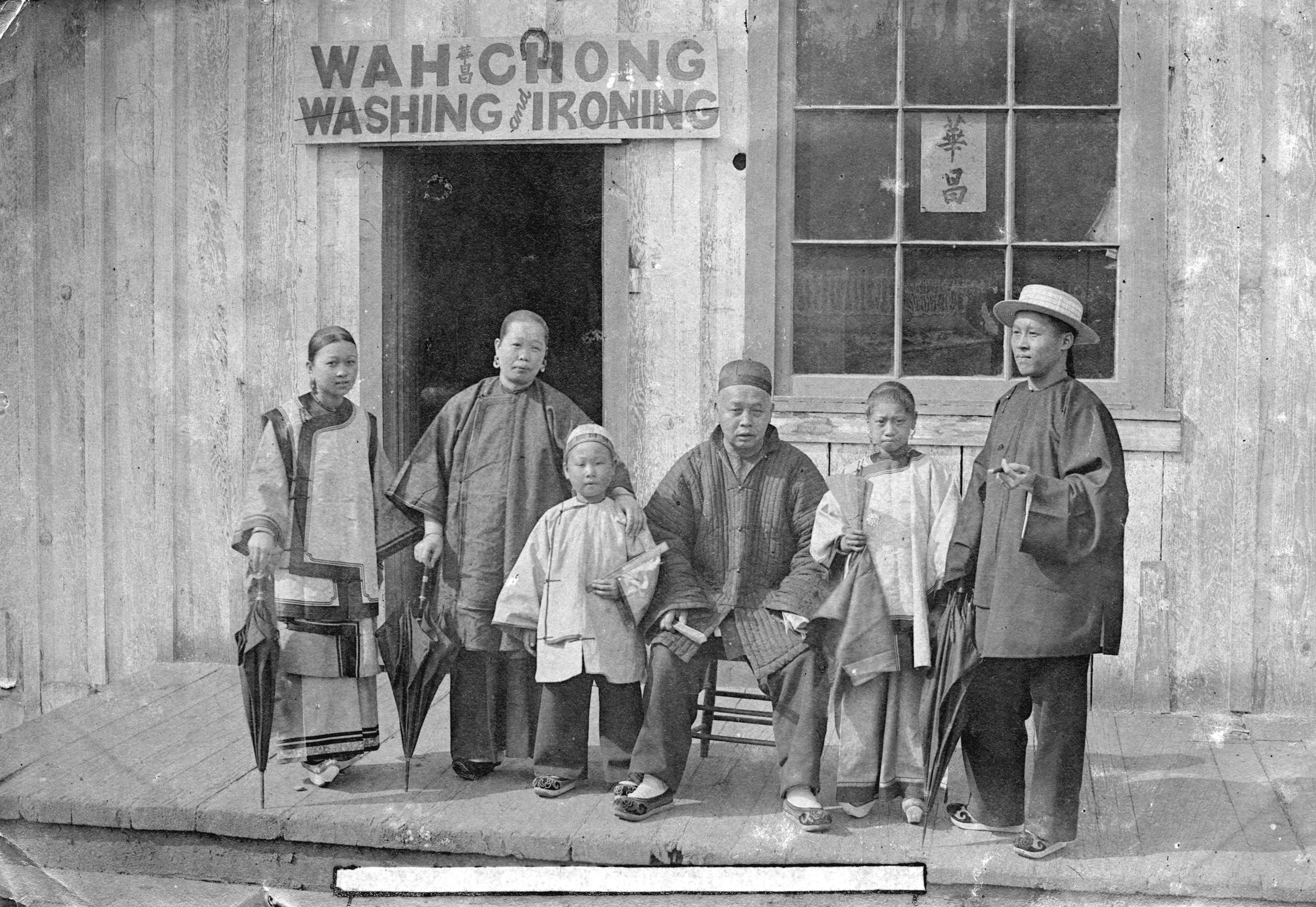 Family in front of Wah Chong Washing and Ironing, 1895.