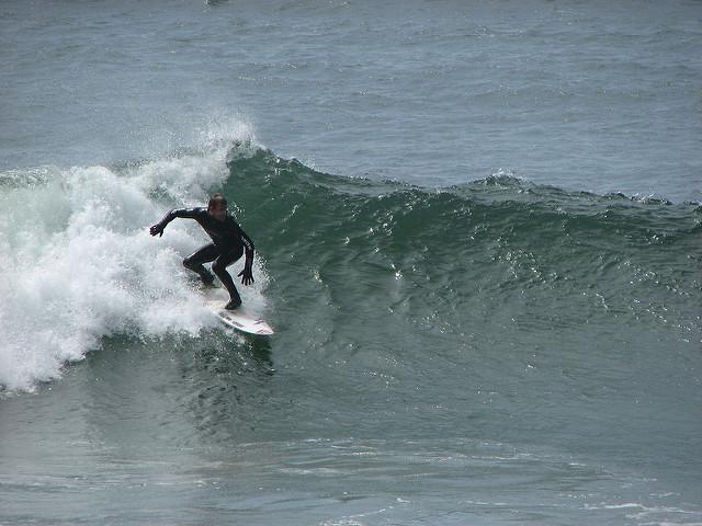 Surfer at Chesterman Beach, Tofino, BC