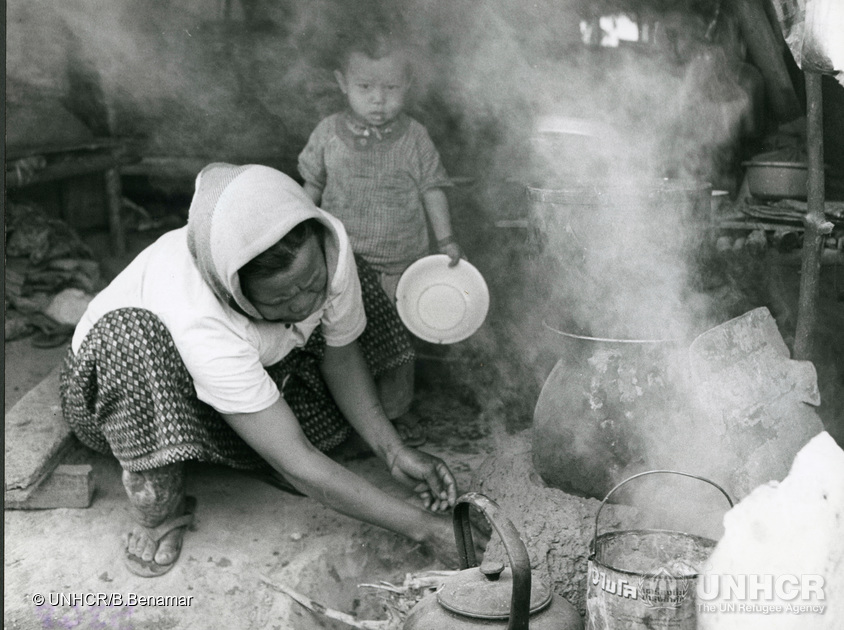 Refugees from Laos use their imagination and ingenuity to cook meals in Nong Khai camp, Thailand