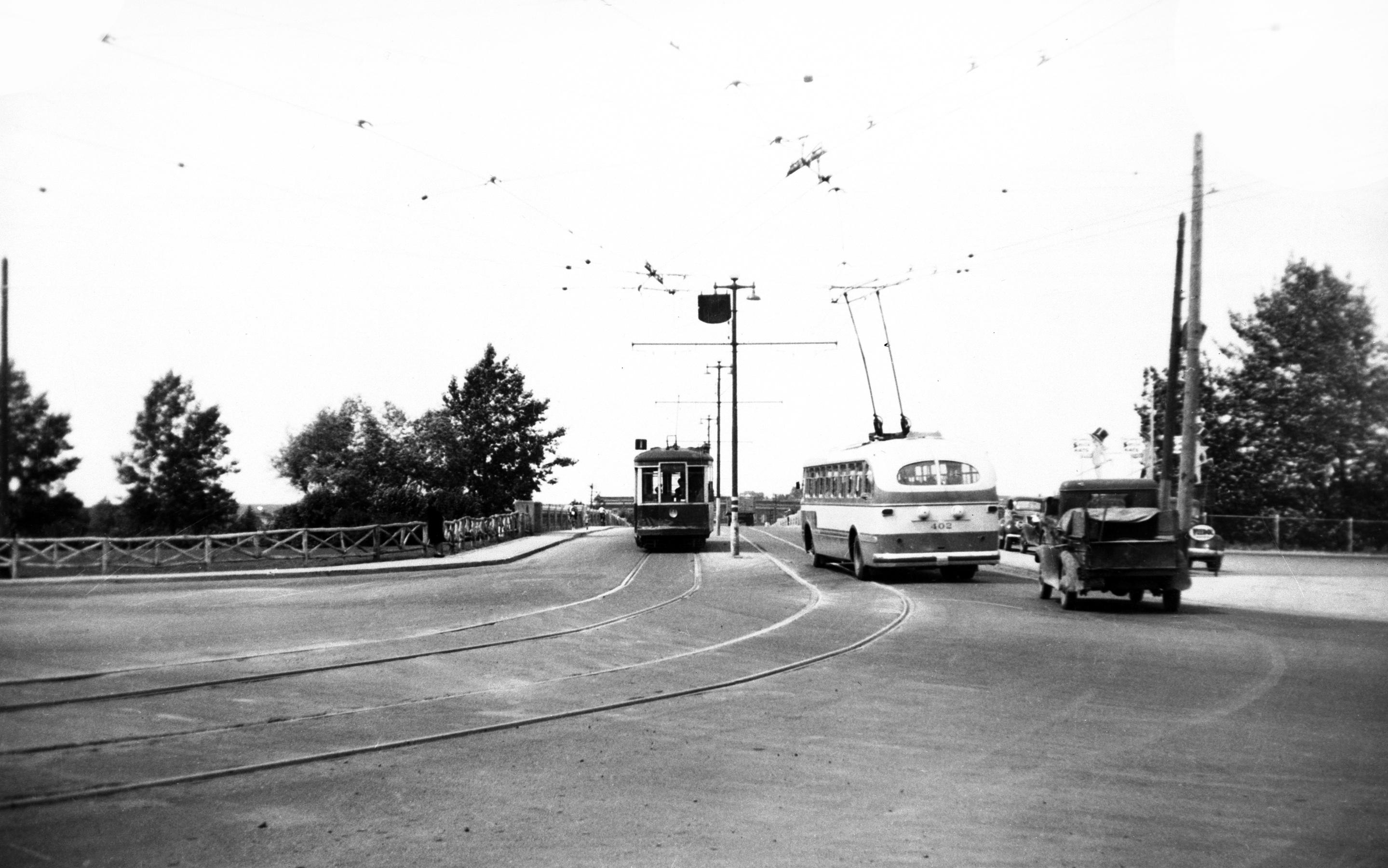 Trolley bus and street railway car on Louise bridge, Calgary, Alberta, 1947