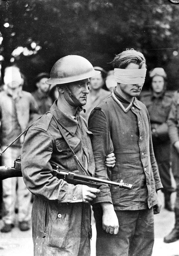 Canadian soldier with German prisoner.