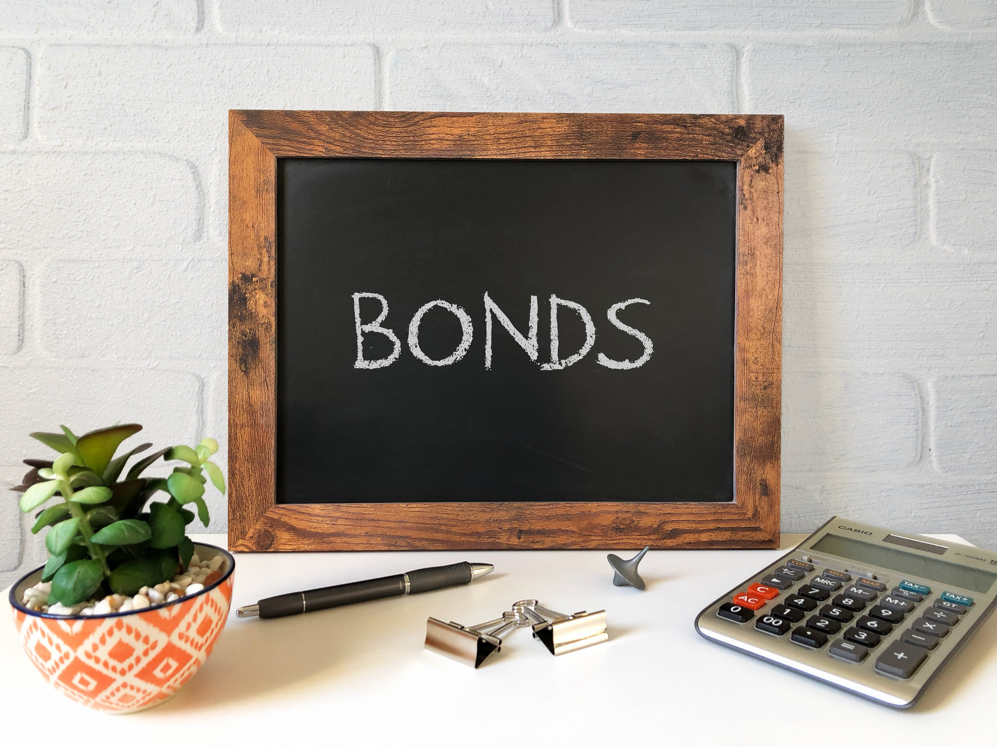 """Chalk board showing the word """"bonds"""""""