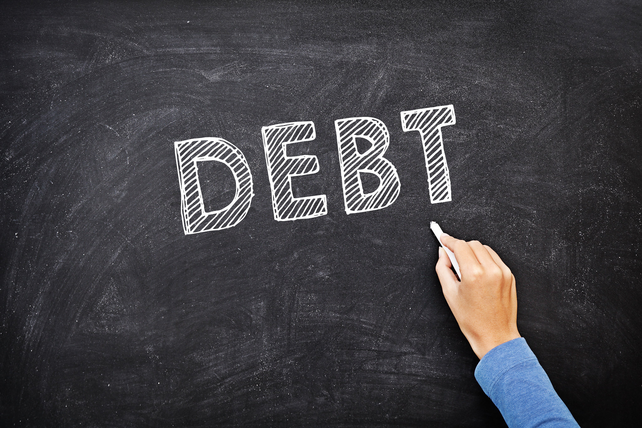 """Chalk board showing the word """"debt"""""""