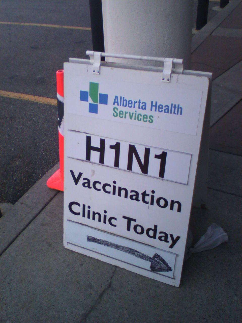 Sign outside a Calgary clinic offering the H1N1 vaccine.