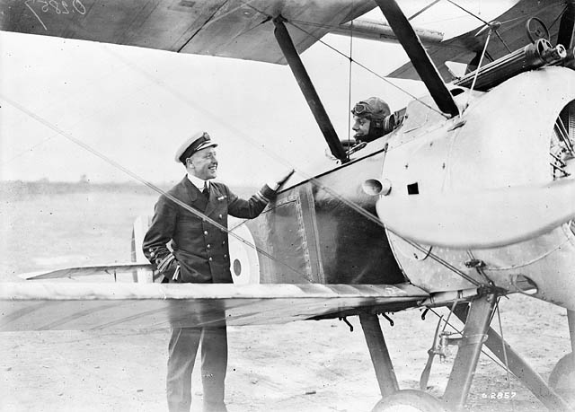 Pilots with Sopwith F. 1 Camel aircraft of No. 203 Squadron, R.A.F., Izel-le-Hameau (Filescamp), France, 12 July 1918. (Left to right): Maj. Raymond Collishaw, Capt. A.T. Whealy.