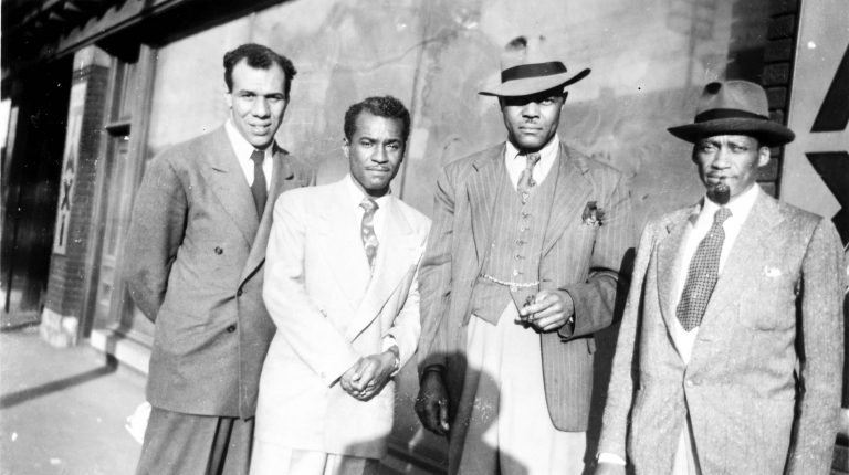 Quatre membres de la Fraternité des porteurs de wagons-lits