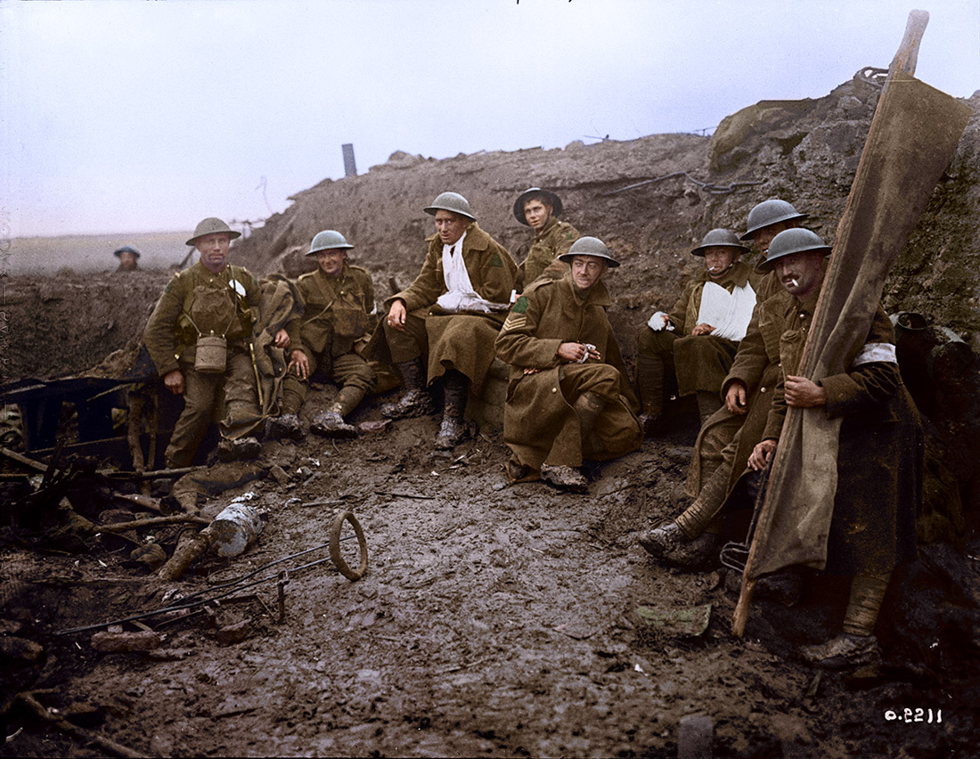 Wounded Canadians taking cover behind pill-box. Battle of Passchendaele. November, 1917.